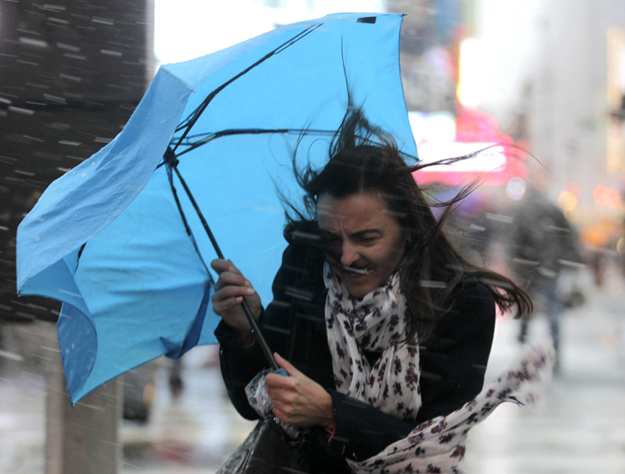 A woman struggles with her umbrella in the wind and snow in New York, November 7, 2012. A wintry storm dropped snow on the Northeast and threatened to bring dangerous winds and flooding to a region still climbing out from the devastation of superstorm Sandy.  (Brendan McDermid/Reuters)