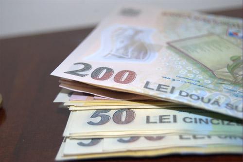 Salariul minim al bugetarilor creşte la 1.000 de lei, din 2014