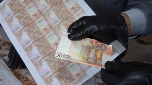 Falsificatori maramureșeni de valută prinși de DIICOT