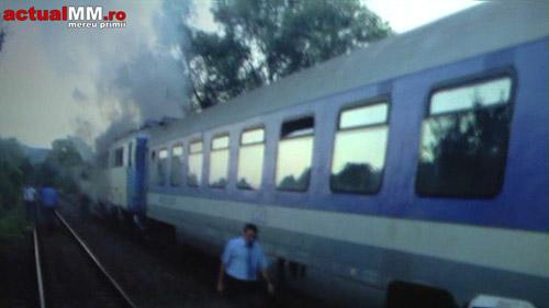 Trenul Satu-Mare – Bucureşti a luat foc