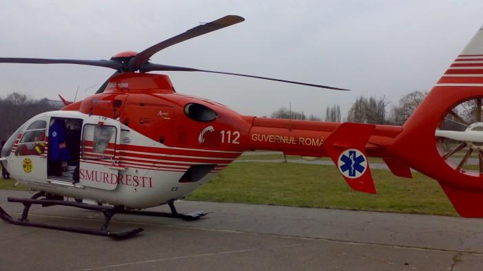 Una dintre victimele accidentului de la Doba, transportată cu elicopterul la București