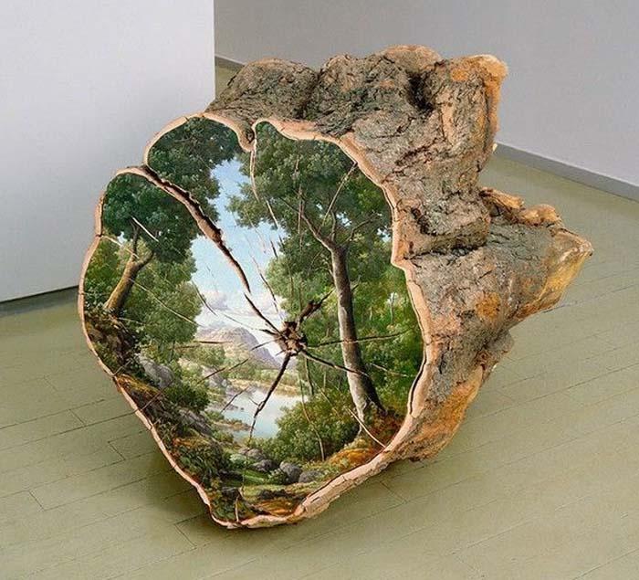 Peisaje pictate pe trunchiurile copacilor doborâți la pământ (Foto)