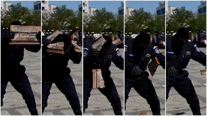 Țiglă făcută țăndări de capul unui jandarm. Vezi filmul demonstrației în câteva fracțiuni de secundă (Foto)